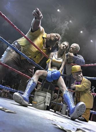 Фото Девушка боксер сидит в углу ринга с тренером