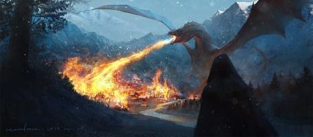 Фото Дракон сжигает деревню в горах