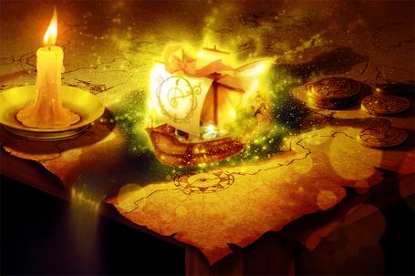 Фото Горящая свеча стоит на карте, из которой появился корабль