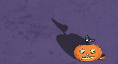 Фото Рисунок кота сидящего в тыкве, в тыкве горит свеча