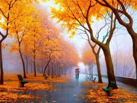 Фото Влюбленные идут под зонтом по дождливому тратуару