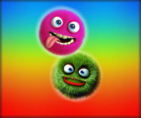Фото Две рожицы монстриков на разноцветном фрне