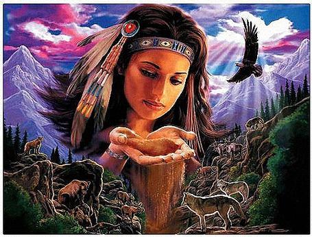Фото Девушка в индейском национальном костюме на фоне заснеженных гор, наливает с ладошек воду в ущелье для зверей пришедших на водопой