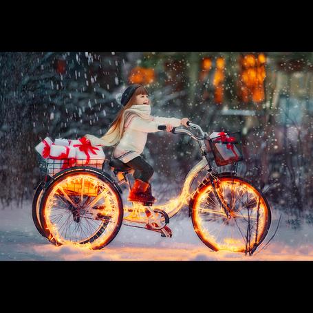 Фото Девочка на велосипеде под снегопадом, фотограф Калмыкова Ирина