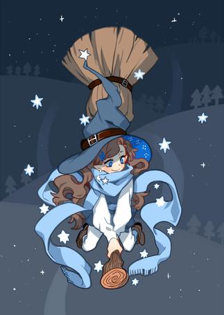 Фото Ведьмочка парит на метле в ночи