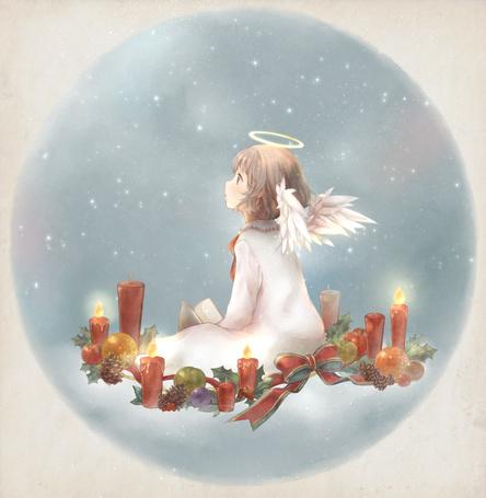 Фото Рождественский ангелочек сидящий на облаке