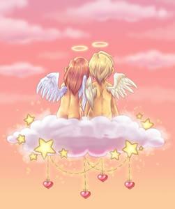 Фото Два оголенных ангелка на облаке