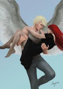 Фото Парень-ангел держит на руках красноволосую девушку