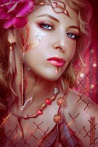 Фото Яркая гламурная красавица со слезами на глазах с украшением на шее и цветком в волосах