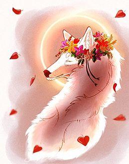 Фото Влюбленная белая волчица в веночке из цветов