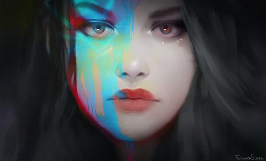 Фото Темноволосая девушка с разноцветными глазами и с окрашенной частью лица в синюю краску на темном фоне / by fdasuarez