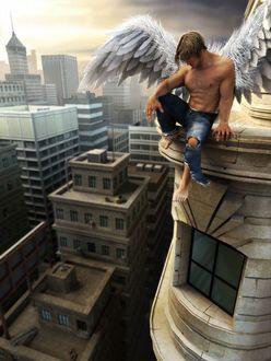 Фото Уставший ангел сидит на крыше
