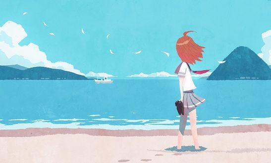 Фото Девочка стоит у моря