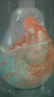Фото Плачущая девушка внутри лампочки