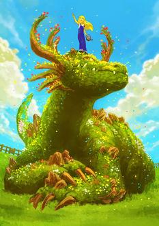 Фото Девочка с лейкой в руке стоит на голове огромного дракона из листьев и цветов
