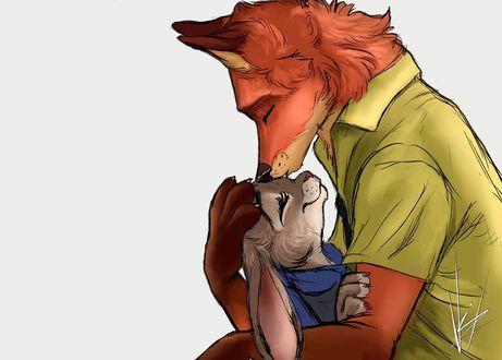 Фото Лис целует в лоб крольчиху