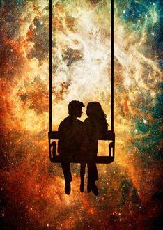 Фото Мужчина с девушкой сидят на качели на фоне космоса, by DV Designstudio