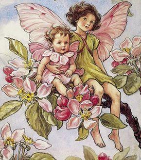 Фото Дети-эльфы раскачиваются на цветущей ветке