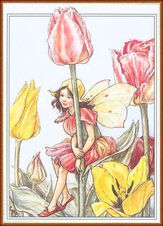 Фото Девочка-эльф отдыхает, сидя на листе прекрасного тюльпана