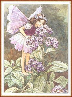 Фото Девочка-эльф нюхает прекрасные цветы