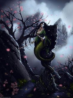 Фото Темноволосая девушка-змея обвилась вокруг высокого камня на фоне дерева и гор, by Lavah