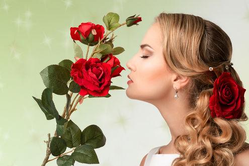 Фото Девушка с красной розой в волосах нюхает красные розы, by Anna Bazhenovskaya