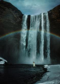 Фото Девушка в белом платье стоит в воде на фоне огромного водопада с радугой, by TJ Drysdale