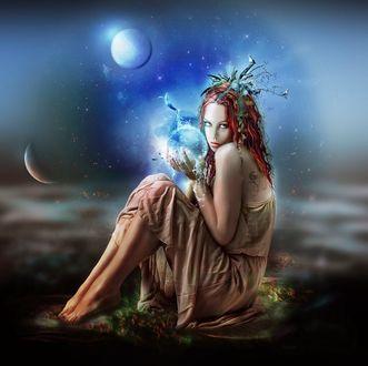 Фото Девушка с рыжими волосами держит магический шар, сидя на земле на фоне луны, by nova63