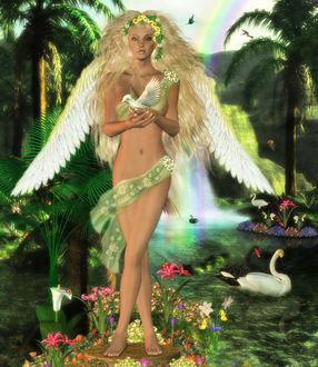 Фото Девушка - ангел с белыми крыльями, с венком из ромашек на голове, тело которой обвито зеленой лентой стоит на пне, на котором растут цветы, держит в руках птенца на фоне пальм, радуги на небе, летающих птиц, плавающих черных и белых лебедей