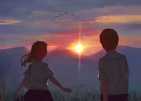 Фото Мальчик и девочка смотрят на птиц летящих в небе на закате солнца, by Krisahe