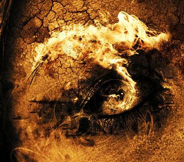 Фото Объятый пламенем человеческий глаз, вокруг которого потрескалась кожа, иллюстрация от by tvlookplay