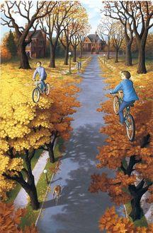 Фото Мальчики едут на велосипедах по кронам деревьев с осенней листвой, по обе стороны аллеи, по которой едет велосипедист, канадский художник Роб Гонзалес