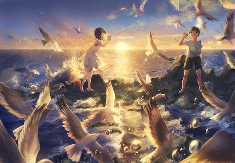 Фото Парень и девушка, в окружении чаек, стоят у моря