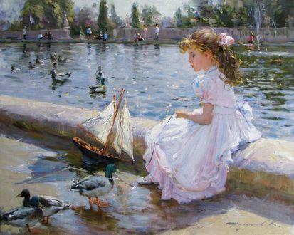 Фото Девочка в белом платье сидит у пруда с утками в городском парке