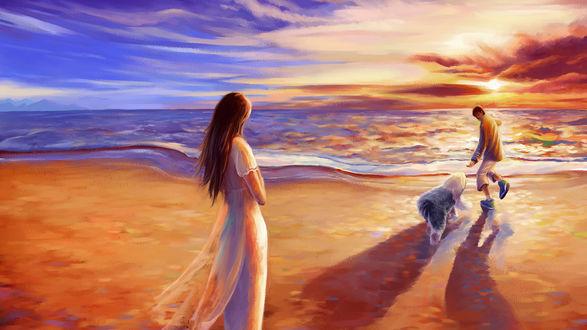 Фото Девушка смотрит на парня который играет с собакой на берегу моря