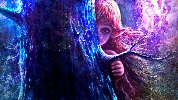 Фото Девочка-эльф выглядывает из-за дерева