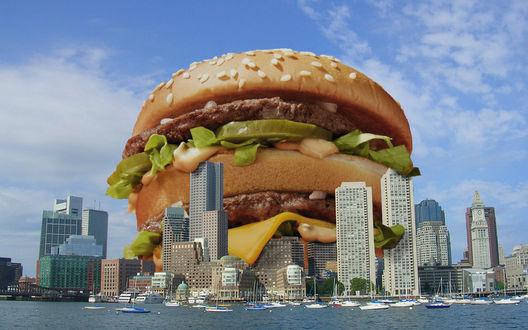 Фото Большой бургер над мегаполисом