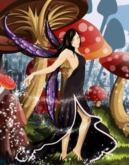 Фото Девушка-эльф с черными длинными волосами в темном платье среди больших мухоморов