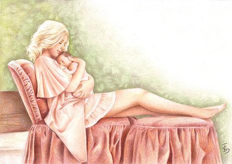 Фото Молодая мама сидя на кресле, с любовью прижимает к себе маленького ребенка, by Israel Llona