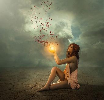 Фото Девушка сидит на земле с магией в руке, by Bels World