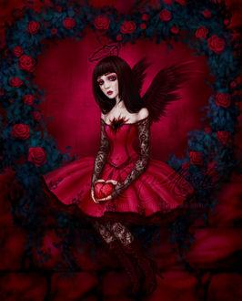 Фото Девочка-ангел с сердечком в руках