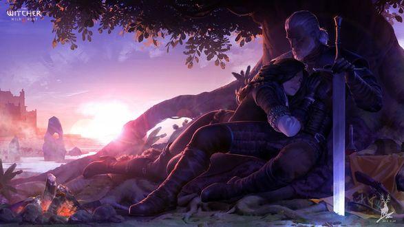 Фото Мужчина и девушка лежат обнявшись под деревом