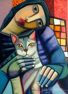 Фото Девушка с кошкой в руках