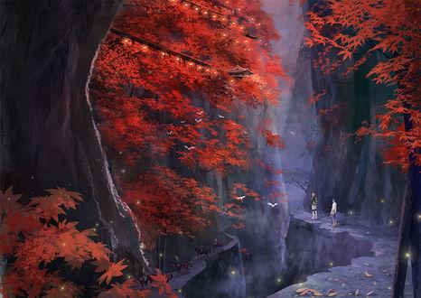 Фото Мальчики стоят перед пропастью, где за осенними деревьями видны японские домики