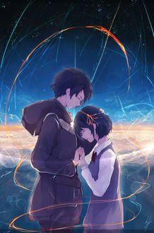 Фото Девушка с ленточкой в волосах и парень стоят рядом на фоне ночного неба