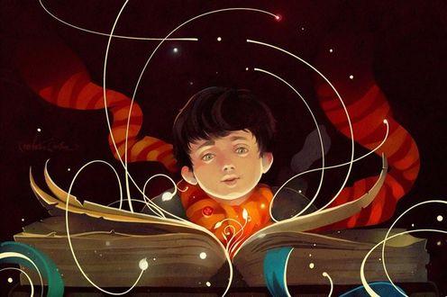 Фото Мальчик сидит над раскрытой волшебной книгой, by Marina Michkina