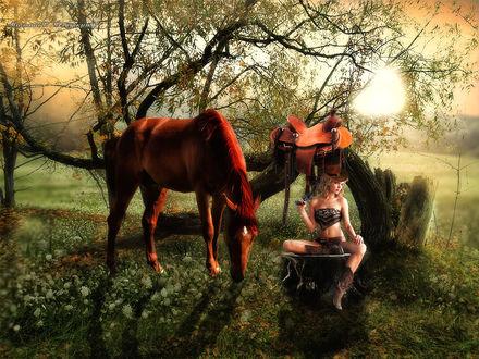 Фото Девушка ковбой отдыхает со своей лошадью на природе