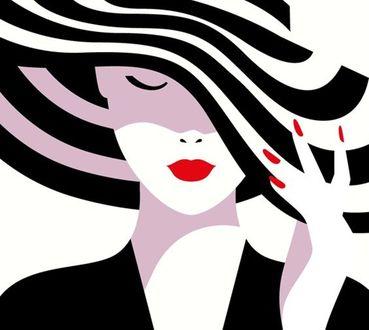 Фото Девушка, прикрыв глаза держся рукой за поля полосатой шляпки