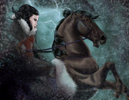 Фото Девушка в зимней одежде сидит верхом на лошади, среди летящих снежинок, на небе сверкают молнии