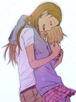 Фото Две девушки обнимаются